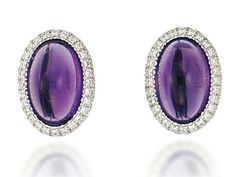 A PAIR OF AMETHYST AND DIAMOND EAR CLIPS, BY MARGHERITA BURGENER Each oval panel set with a cabochon amethyst centre to a double line pavé-set brilliant-cut diamond border, 2.0cm long, maker's pouch Signed Margherita Burgener