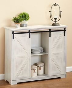 The Barn Door-Style Buffet Cabinet is a hefty unit that offers plenty of storage space. It features 2 sliding doors that always leave of the interior expose Kitchen Display Cabinet, Barn Door Cabinet, Buffet Cabinet, Sideboard Buffet, Cabinet With Doors, Display Cabinets, Kitchen Cabinets, Door Furniture, Home Decor Furniture