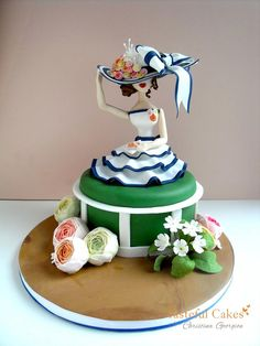 Tasteful Cakes - woman  sitting and holding down her hat