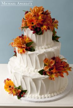 Fall Texture #10Specialty This three-tier buttercream cake is textured for a unique look. Then Fall flowers were brought in and placed on each layer.