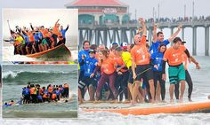 66 surfers set world record for most people riding one board at once #DailyMail