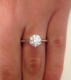 Exactly what I want. A 1+ carat solitaire with an 18k band that tapers as it gets to the center of the stone. I don't want the stone too high that it can get caught on anything. Six small prongs hold it tight. This ring would be perfect paired with an eternity wedding band