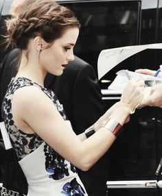 Love Emma Watson's dress and hair here  (Emma, knowing she would be pinned next to a black and white bathroom, went for a matching outfit.)