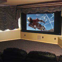 This family room wasn't the best space for a dedicated theater, but the installers worked with the layout to create a cozy constant image height theater.