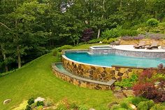sloped-backyard-pool-ideas new rochelle swimming pool Gone are the days when decorating was a one-and-carried out deal. Backyard Pool Landscaping, Swimming Pools Backyard, Landscaping Ideas, Backyard Ideas, Garden Ideas, Steep Backyard, Landscaping Edging, Luxury Landscaping, Pool Spa