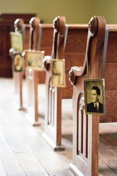 Framed family photos lining the ceremony aisle