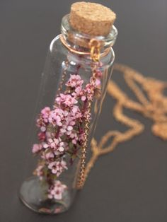 Just Me - Pink diamond flower in a glass bottle vintage brass chain necklace