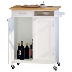 The quaint, Rolling Kitchen Workstation Cart , gives all the kitchen island use in a space saving unit. Butcher block top which features a unique and. Kitchen Island Cart, Kitchen Carts, Kitchen Islands, Kitchen Ideas, Kitchen Work Station, Microwave Cart, Butcher Block Top, Home Bar Decor, Traditional Kitchen