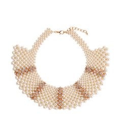 Give old Hollywood a nod with this intricate beaded collar necklace. We love the true statement it makes, pairing vintage-inspired rhinestones with classic white pearls. Flexible which makes for easy wearing. Pair with a black crop, heels and trousers for a modern-yet-traditional look!      Glass Crystal  Adjustable  Imported