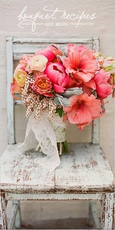 A pop of salmon colored hibiscus flowers and a hint of lace makes for a very pretty, classic bouquet.