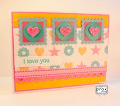 """Love You card made with:  - Gina K Designs """"Stamp It Big!"""" by Carolyn Gimpel King.  - Gina K Designs Pure Luxury 80lb and 120 lb Base Weight White card stock.  - Gina K Designs Pure Luxury Bubblegum Pink card stock.  - Gina K Designs Pure Luxury Wild Dandelion card stock.  - Gina K Designs Pure Luxury Little Boy Blue card stock.  - Gina K Designs Color Companions Ribbon- Innocent Pink Double Stitched.  - Gina K Designs Color Companions Ink Pad - Innocent Pink and Ocean Mist."""