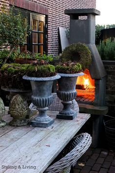 Brick patio, contemporary fire place and potted plants