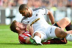 Sunderland's Connor Wickham (left) argues with Swansea City's Ashley Williams