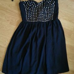 Midnight Blue Dress Also available in MEDIUM/LARGE Brand new, never worn, bought without a tag, midnight blue, has silver studs, and you can adjust the top of the dress accordingly to bust size. This short dress is flowy, fun and great for parties!! Can fit a MEDIUM Unbranded Dresses