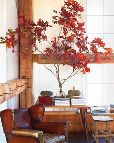 Red Foliage  One temporary way to bring autumn indoors is to create a natural display such as a blazing tree branch and greenish gourds.
