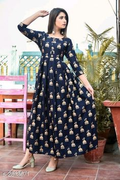 Gowns Partywear Rayon Printed Women's Gown Fabric: Rayon Sleeves: Sleeves Are Included  Size:  M - 38 in L - 40 in XL - 42 in XXL - 44 in  Length: Up To 53 in Type: Stitched Description: It Has 1 Piece Of Women's Gown  Work: Printed Country of Origin: India Sizes Available: M, L, XL, XXL, XXXL   Catalog Rating: ★4.3 (427)  Catalog Name: Pihu Partywear Rayon Printed Women's Gowns Vol 5 CatalogID_381961 C79-SC1289 Code: 015-2813671-7131