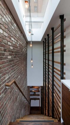 modern stairway. love the exposed brick and lighting.