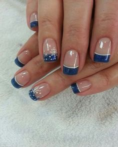 Midnight blue colored French tips with snowflakes in white polish. Use glitter polish for the midnight blue French tips and top off the design with pretty white snowflakes.
