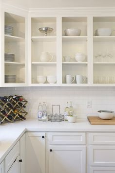 Fabulous white kitchen features upper cabinets, with no doors, used as display s. Fabulous white kitchen features upper cabinets, with no doors, used as display shelves filled with white pottery. New Kitchen Cabinet Doors, Farmhouse Kitchen Cabinets, Kitchen Cupboards, Cocinas Color Chocolate, Classic Kitchen, Cocinas Kitchen, Upper Cabinets, Ikea Cabinets, Shaker Cabinets