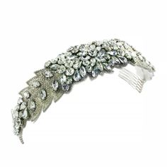 Unique and incredibly detailed, this headband is made with prong-set crystals and seed beads.  Backed with white ultra-suede for added comfort.  Flexible band with combs attached. | GIAVAN