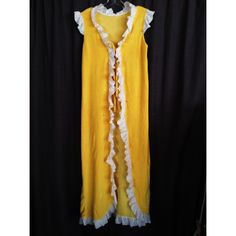 Amazing 1970s Vintage Robe Truly amazing. Yellow gold terry cloth fabric with ruffles. This thing could easily be worn to a festival! Could fit any size really. Such an awesome piece. Two slight brown stains as pictured in last photo. First picture shows whole garment. Vintage Intimates & Sleepwear Robes