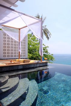 conversation pit next to the infinity pool overlooking the sea. why can't this be ours?