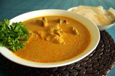 Spicy Chicken gravy with thin rice crispy wafers - Kori Rotti