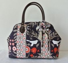 Boston bag with a corsage Patchwork Bird & Flower in di tagodesign, $85.90