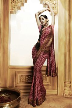 Cute Saree... but I wouldn't pose like that.