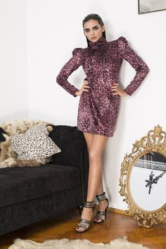 Velvet rush and '80s crush. The '80s are wildly popular these days and we're joining the season's hottest trend in this thigh-grazing dress cut in pink leopard print velvet. Yes, you read that right, we did say pink. Featuring ruched power shoulders, sexy keyhole back and universally slimming roll neck. Pink Leopard Print, Disco Ball, Dress Cuts, Roll Neck, Leather Leggings, 80s Fashion, Rock And Roll, Thighs, Party Dress