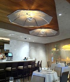 custom umbrella pendants in a polished chrome metal finish for the Las Vegas Estiatorio Milos restaurant in The Cosmopolitan. Lamping is mirrored G40 incandescent.