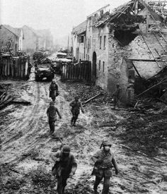 At the height of the Battle of the Bulge, American infantrymen advance through the muddy streets of a French village. Although taken by surprise, the Americans rallied to resist the German offensive.