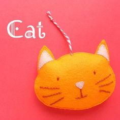 Cat Ornament Pattern - Make a fun felt ornament with this easy pattern from Shiny Happy World. :-)