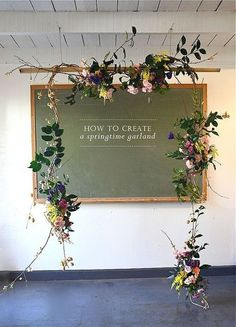 Floral garland with clusters of flowers and traily greenery