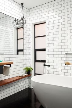 Reece Spring Bathroom - White tiles in brick layout Charcoal tiles