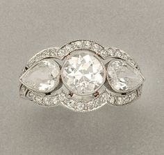 Diamond Ring   Platinum, one diamond ap. 1.15 cts., 2 diamonds ap. 1.00 ct., c. 1920, ap. 3.4 dwt