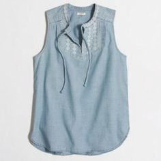 J. Crew chambray tassel shirt Cotton.   Machine wash. From Factory.  1st photo from J.Crewfactory.com J. Crew Tops