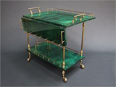 1950's Bar cart by Aldo tura, Italy.  I can't imagine the cost but it sure is gorgeous!