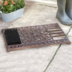 Banish dirt and muddy footprints from your home with this fantastic multipurpose doorway solution.  Made from weatherproof cast iron and finished in classic garden brown this intricately designed, rectangular doormat features a boot brush to one side made from durable coco fibres and a handy heavy duty scraper to the other side.  This cast iron doormat with brush and scraper is a great space saving alternative for those smaller entrances as well as a wonderful addition to your house.