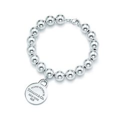 Tiffany silver beads with charm