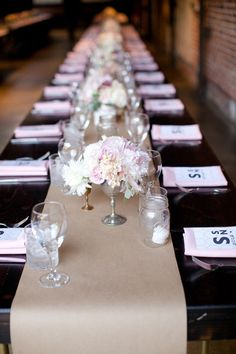 Tablescape with a simple paper runner and beautiful delicate centerpieces.