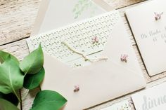 Laser Cut folder Wedding invitation by Shindig Bespoke •Photo by Elaina Mortali