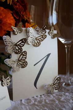 Handmade wedding table number card. I like this idea but with fall leaves.