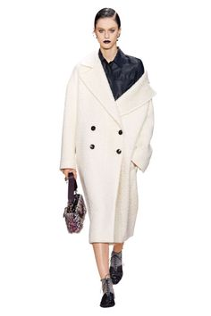 Runway's best toppers—blown up to cartoonish proportions—have got you more than covered. Check out this Christian Dior. Helena Bordon, Anna Dello Russo, Giovanna Battaglia, Oversized Coat, Sarah Jessica Parker, What's Trending, Alexa Chung, Blake Lively, Kate Moss
