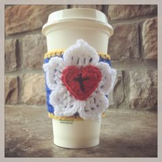 Luther's Rose crochet coffee cozy. Facebook.com/lalalilyboutique