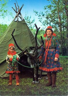 A Sami woman and child with their reindeer. The Sami people live in Lapland in northern part of Finland