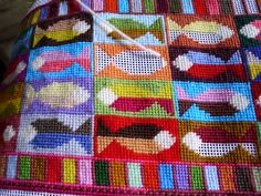 A needlepoint draught excluder in the making.