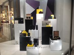 Monochrome plinths keep the focus on the product with pops of yellow adding interest to catch the eye.