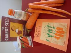 Baby carrot seed packets.  Fingers are the carrots on top of colored dirt and stamped leaves.  Food from the Farm month.