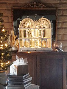 Glowing Birdcage...Hang String lights from the inside to produce an inviting glow!